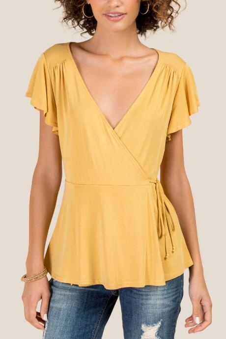 Arie Flutter Sleeve Wrap Top - Marigold by francesca's