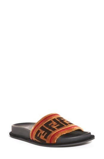 A fierce logo print adds signature attitude to a clean, classic slide sandal done in plush velvet. Style Name: Fendi Logo Slide Sandal (Women). Style Number: 5483448. Available in stores.