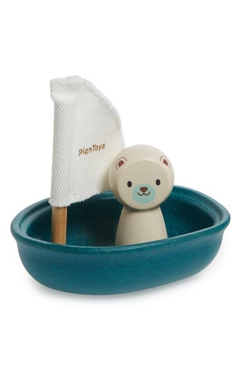 A smiling polar bear helms this charming sailboat that's ready to take your little one on splashy adventures in the tub, pool or lake. Crafted from buoyant rubberwood, it's sized especially for little hands and growing imaginations. Style Name: Plan Toys Polar Bear Sailing Boat Toy. Style Number: 5632253. Available in stores.