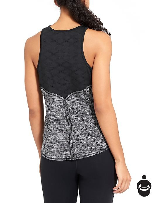 Lightweight and cool, this semi-fitted gym tank features mesh insets in prime sweat zones to give you ventilation where you need it.