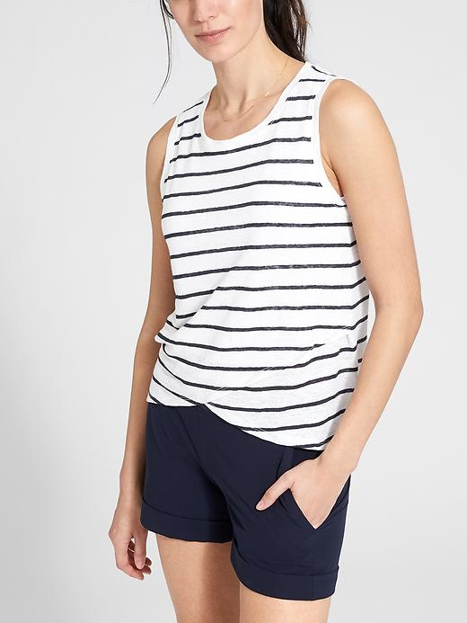 The high-low hem on this breathable linen jersey tank offers full coverage with a touch of style and pairs perfectly with any drawstring pants.
