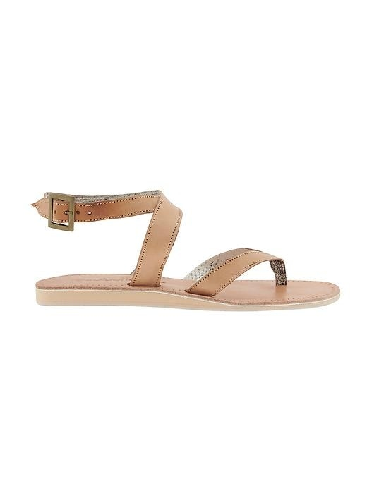 The snakeskin lining on this leather thong with ankle strap adds comfort and style, making it the perfect sandal for wearing from beach to street.