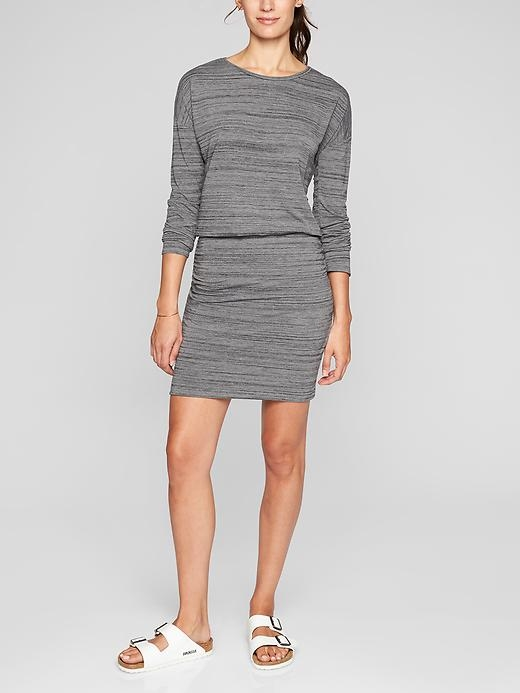 Unbelievably soft fabric that's plush on the skin, flattering ruching along the sides, and a chic blouson fit (loose on top, fitted through the skirt) make this the summer-to-fall dress you need.