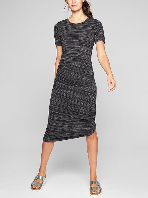 Start with amazingly soft fabric that's plush on the skin, add ruching along the sides to flatter the figure, and design it with the stylish asymm hem we love for our favorite everyday-to-getaway dress.