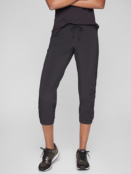 The ruched, banded-cuff capri made from quick-drying recycled Featherweight Stretch that layers well over shorts on the way to and from the gym.