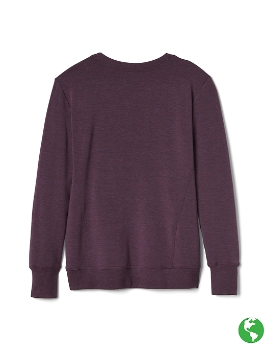 This cozy sweatshirt with thumbholes and a kangaroo pocket pairs perfectly with your favorite tights.
