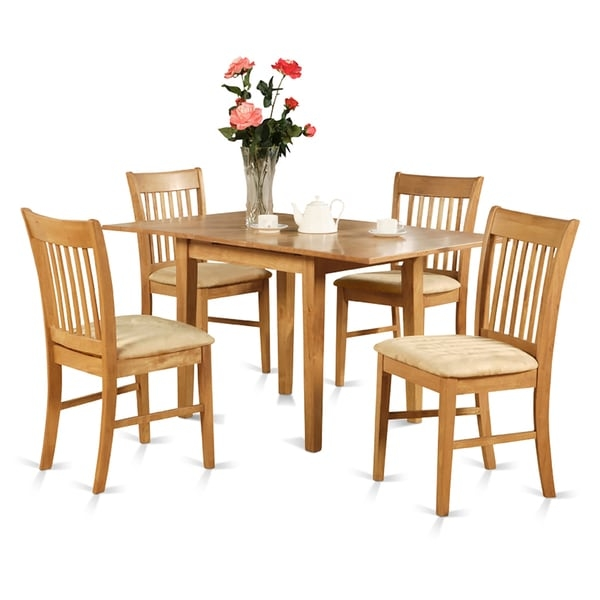 Have supper in luxurious and incredibly coziness with Norfolk dinette table sets. This table and chair set gives high quality style with a touch of elegance to add in dynamic beauty to any dinette table. A handy 12-inch self-storage extendable leaf gives you more space. Norfolk dinette table sets are crafted from the finest Asian hardwood. hardwood or upholstered seats provide lovely design and comfort for this small kitchen table set. Table are finished in a classic oak color.   First-rate Dining set which constructed with all Asian Hardwood. Absolutely no MDF, veneer, laminate utilized for this products. Kitchen Table Has 12 In Self Storage Leaf Which Can Be Stored Right Underneath Table Top.     Assembly Required         Shape: Rectangle   Furniture Room: Dining Room, Kitchen   Material: Rubberwood   Style: Traditional, Casual, Country   Assembly: Assembly Required   Exact Color: Oak   Finish: Oak Finish   Size: 7-Piece Sets   Color: Brown        Please note: Orders of 151 pounds or more will be shipped via Freight carrier and our Oversized Item Delivery/Return policy will apply.  Please click here for more information.
