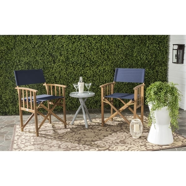 Give your porch or patio a touch of Hollywood glam with a pretty and practical set of two Laguna outdoor director chairs. These folding chairs are crafted of eco-friendly acacia wood in a teak finish with spiffy blue all-weather Textilene fabric.     Features:        Chair Type: Folding Chairs, Chair & Ottoman Sets     Contemporary style     Crafted of Acacia, Fabric     Chair Back Height: Standard     Size: 2-Piece Sets     Color: Blue, Brown        Assembly Required