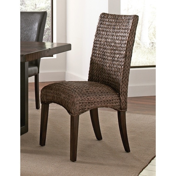 Mahogany and Banana Leaf Dark Brown Woven Dining Chair      Chair Type: Dining Chairs  Material: Mahogany  Assembly: Assembly Required  Set Size: Set of 2  Color: Brown  22.75 inches long x 18.25 inches wide x 40.25 inches high       Assembly Required