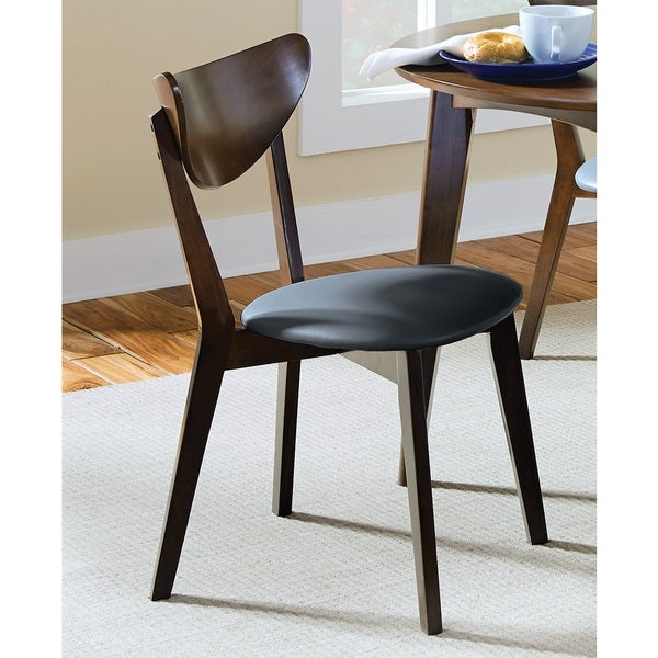 Brown leatherette parson chair.          Chair Type: Dining Chairs   Material: Faux Leather   Assembly: Assembly Required   Set Size: Set of 2   Finish: Walnut Finish   Color: Brown  38.75 inches high x 19.25 inches wide x 25.5 inches deep               Assembly Required
