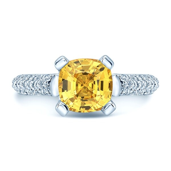 Bright and fashionable, this vibrant diamond ring is beautifully crafted from 18-karat white gold to add shimmering sophistication to your style. The ring features a gorgeous cushion-cut yellow sapphire, the bright stone raised in a cathedral setting. Glittering white diamonds encrust the domed shank, completing the look of this vibrant ring.     Features:     Size 5  18k white gold  High polish finish  Prong and pave setting  5.8 mm wide x 5.8 mm long    White Diamonds:    3/4 carat  H-I color  Round cut  SI1-SI2 clarity  142 diamonds  Natural diamonds  Certified diamond    Yellow Sapphire:    1 carat  Yellow color  Cushion cut  One sapphire   Diamond total weight: 3/4* carat TW       All weights and measurements are approximate and may vary slightly from the listed information. *T.W. (total weight) is approximate. 3/4 carat T.W. may be 0.68 to 0.79 carats. Treatment code N (diamond), and E (sapphire). See   Treatment Guide   for further information.      Click here for ring sizing guide        High Value Notice: If security tag is removed, item may not be returnable. Click here for more information.        All measurements are approximate and may vary slightly from the listed dimensions.     Click here for help finding your ring size.     T.W. (total weight) is approximate. The weight may vary up to two-tenths of a carat.     High Value Notice: If security tag is removed, item may not be returnable.  Click here for more information.