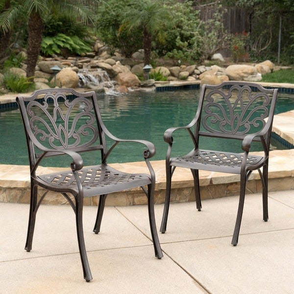 These outdoor dining chairs are the perfect addition to your patio. Featuring a cast aluminum build which provides a sturdy frame with a light weight, allowing you to move these chairs wherever you need them. The design work on the chair back has a natural feeling of waves and flowers, providing the perfect atmosphere for your outdoor space.      Includes: Two (2) chair   Material: Cast aluminum   Color: Bronze   Assembly required: Yes   Weight: 20-pounds   Dimensions: 36.50 inches high x 20.50 inches wide x 27.50 inches deep    Seat dimensions: 16.75 inches high x 18.75 inches wide x 18.50 inches deep   Armrest dimensions: 24.75 inches high         Product Features: Water Resistant   Chair Type: Accent Chairs, Dining Chairs   Material: Aluminum   Assembly: Assembly Required   Chair Back Height: Standard   Exact Color: Brown   Color: Brown   Size: 2-Piece Sets         Assembly Required        Assembly Required