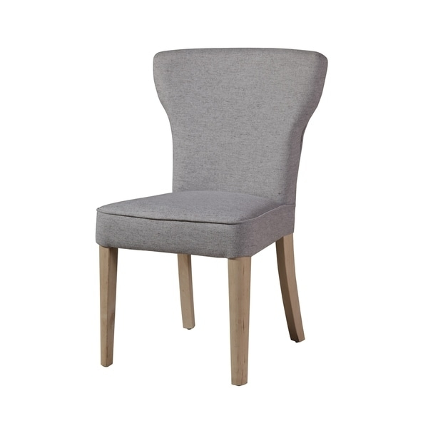 Elevate the elegance in your dining room with this contemporary and sophisticated dining chair. Upholstered in a soft grey, this chair showcases a slightly winged back and finely tapered birchwood feet for a chic statement.      Features:     Upholstered dining chair  Solid grey fabric  Vertical back  Measures 19.5 inches x 21 inches x 34 inches