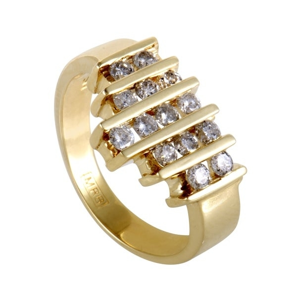 Click here for help finding your ring size.   Exuding their prestigious brilliance against the enchanting radiance of yellow gold, the fascinating diamonds totaling 0.55ct are arranged in an intriguing manner in this gorgeous and stylish ring. Ring Top Dimensions: 15 x 12mm     All measurements are approximate and may vary slightly from the listed dimensions.      T.W. (total weight) is approximate. The weight may vary up to two-tenths of a carat.      Treatment code N for main stone. See   Treatment Guide   for all treatment code information.