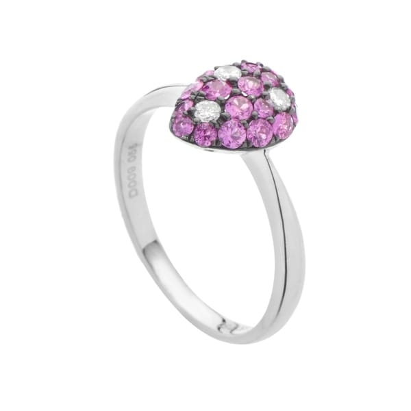 Click here for help finding your ring size.   A gorgeous blend of romantic rubies weighing in total 0.55ct and glittering diamonds amounting to 0.09ct is placed upon a splendid white gold body in this remarkably tasteful ring. Ring Size: 8 x 10mm     All measurements are approximate and may vary slightly from the listed dimensions.      T.W. (total weight) is approximate. The weight may vary up to two-tenths of a carat.      Treatment code N for main stone. See   Treatment Guide   for all treatment code information.