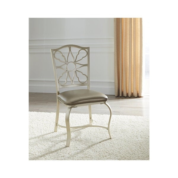Elegance has no limits in the Shollyn upholstered side chair. Filigree back design exhibits gorgeous metalwork.        Chair Design: Side Chair   Chair Type: Dining Chairs   Material: Wood, MDF, Metal   Assembly: Assembled   Set Size: Set of 2   Back Style: Decorative   Finish: Wood Finish   Color: Grey