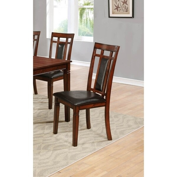 """Includes: (2) Side Chairs. Chair is made of solid and manufacture wood.  Upholstered in faux leather in espresso color. Backframe has a slat back with firm padded seat cushion.  Side Chair 18""""L x 23""""D x 39""""H. Seat Height 19. Seat Depth 17.5. Transitional Style.     Assembly Required"""