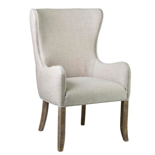 Relax during dinner on this East at Main Anne dining chair, which features a solid back for support. with its streamlined armchair shape and beige upholstery, this chair brings a contemporary twist to a traditional dining room.    Style: Contemporary  Material: Oak, fabric  Color: Beige  Chair type: Dining chair  Chair design: Armchair  Features: Handmade  Set size: Single  Dimensions: 26.3 inches x 26.8 inches x 41.7 inches