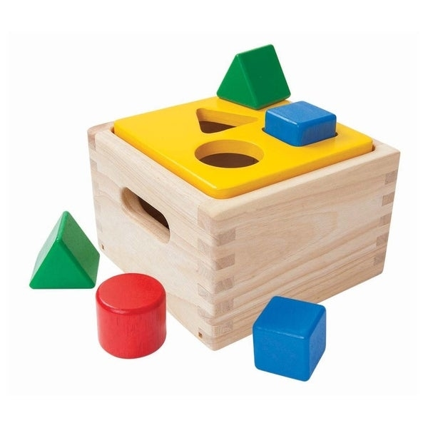 The PlanToys Shape and Sort It Out will keep your little one entertained. This baby toy has 3 different shapes that can be pushed through the holes. Your little one will love figuring out which shapes go into which hole. This set focuses on motor skills, learning shapes and colors and creative thinking. You don't need to worry about the safety of this wooden toy because it's made from sustainable rubber wood and coated with a non-toxic finish. Encourages recognition of colors and shapes as well as the development of hand-eye coordination. All colors are made from vegetable dye. For ages 12 months and up.