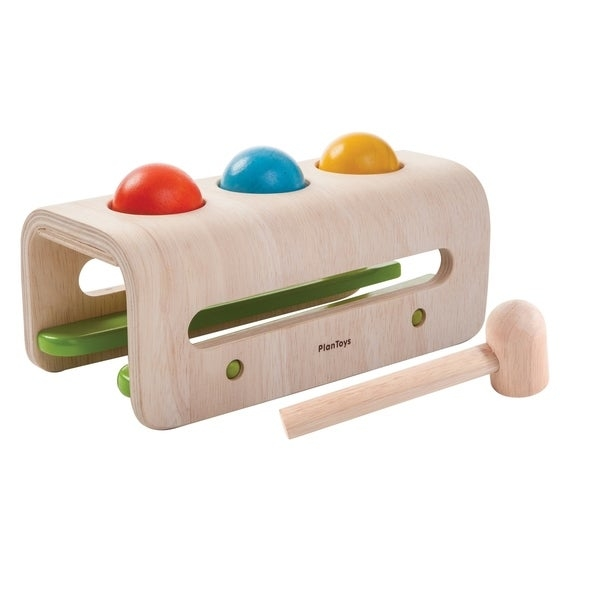 Plan Toy Hammer Ball helps children to improve hand-eye coordination, aligning slotting and aiming. They have so much fun hitting the balls and watching them roll out of the box. There are three bright colored wooden balls, a hammer and a Euro-contemporary bench. Great for developing handeye coordination. Hammer The Balls And Watch Them Drop Then Roll Back To You. Beautiful EuroContemporary Styling. There Are Three Bright Colored Wooden Balls A Hammer And Curved Bench. This Toy Is Made From All Natural Recycled Rubber Wood.     WARNING:   Attention California residents: This product may contain chemicals known to the State of California to cause cancer and birth defects or other reproductive harm.   www.P65Warnings.ca.gov