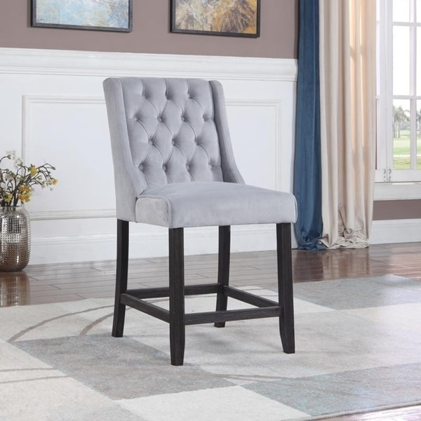 "Includes: Two (2) Bar Chairs. Chairs are upholstered in polyester blend fabric with tufted back. Medium firm seating. Legs are finished in a distressed finish. Comes with footrest. 25 Inches measured from floor to top of seat. 18"" Seat Depth. Assembled dimension 21""L x 25""D x 40""H. Contemporary and Casusal Style. Suitable for kitchen, dining and/ or game room.      Assembly Required"
