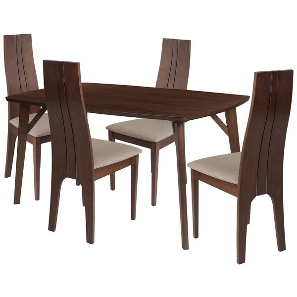 Make any meal special by bringing the family together. The table features a large, smooth surface for everyone to sit around and eat. This dining table set comes complete with four chairs. Chair features a curved, double slit open designer back with silver accents.      This product will ship to you in multiple boxes.        Assembly Required