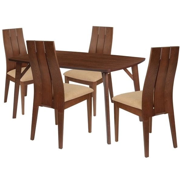 Make any meal special by bringing the family together. The table features a large, smooth surface for everyone to sit around and eat. This dining table set comes complete with four chairs. Chair features a curved, double slit open designer back.      This product will ship to you in multiple boxes.        Assembly Required