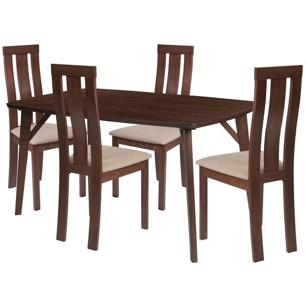 Make any meal special by bringing the family together. The table features a large, smooth surface for everyone to sit around and eat. This dining table set comes complete with four chairs. Chair features a curved, vertical slat back design.      This product will ship to you in multiple boxes.        Assembly Required