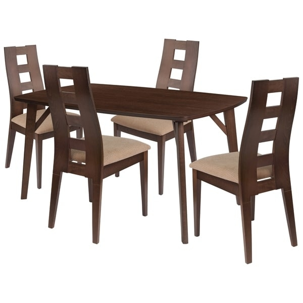 Make any meal special by bringing the family together. The table features a large, smooth surface for everyone to sit around and eat. This dining table set comes complete with four chairs. Chair features a curved, attractive window pane cutout back.      This product will ship to you in multiple boxes.        Assembly Required