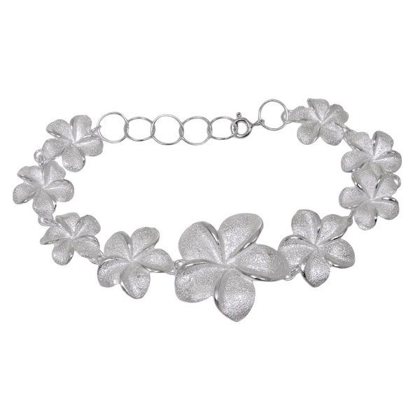 Ethereal beauty of frangipani is transformed into a design of timeless elegance with this bracelet Bracelet links different sized pebbled-texture blossoms Jewelry is crafted of .925 silver