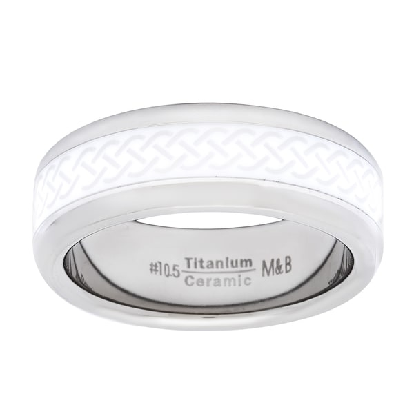 Add a unique accent to your style with a titanium and ceramic   spinner ring    Ring features a polished titanium outer band with a movable   ceramic inner band    Jewelry piece features a black on white knot pattern on the   inner band    Measures 7 mm wide      All weights and measurements are approximate and may vary   slightly from the listed information.        Click here for Ring Sizing Chart.    See     Treatment Guide   for further information.      All measurements are approximate and may vary slightly from the listed dimensions.