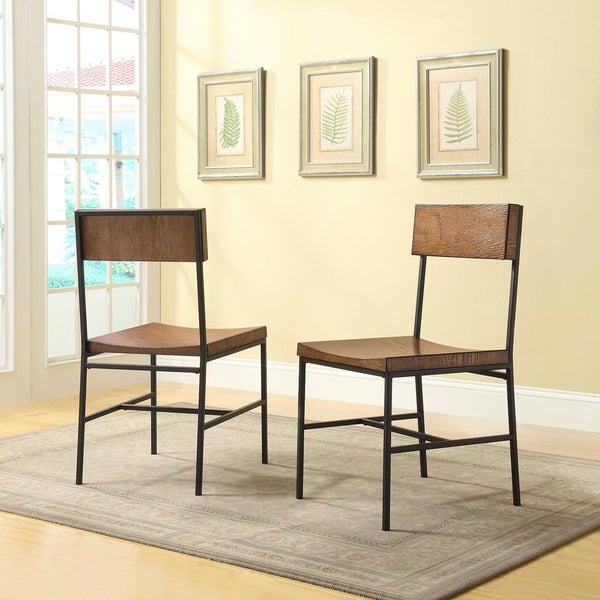 This dining chair has a modern rustic design. With its old schoolhouse seats and textured metal frame, this versatile chair owes its good looks to the rich colors and metal frame.    Set includes: Two (2) Chairs  Modern rustic design  Beautiful four step seat and back rest  Powder coated textured metal frame  Comfortable schoolhouse seat  This product is intended for Residential Use Only.  Manufacturer's Warranty (including Return Policy) is null and void if used in an improper setting  Finish: Chestnut/textured Black, white/black, natural/black  Materials: Steel, veneer, MDF  Weight Capacity: 250 lbs  Seat dimensions: 17.5 inches long x 17.125 inches wide x 18 inches high  Dimensions (overall): 17.25 inches wide x 19.25 inches deep x 33.5 inches high     Assembly required.