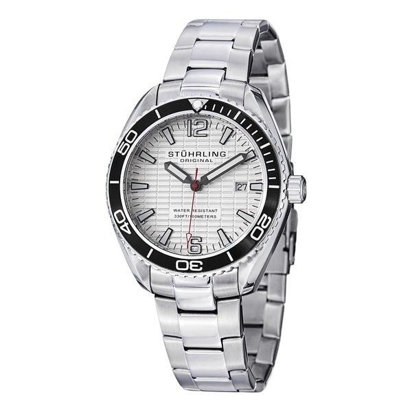 A great look and a great timepiece, this stainless steel silvertonebracelet watch from Stuhrling Original is both stylish andfunctional. Its 42 millimeter round case and silver dial create anelegant look for any man's casual attire. Additionally, this watchis water resistant up to 330 feet and contains a Swiss quartzmovement for precise timekeeping.     Case: 316L Surgical Grade Stainless Steel Silver   Caseback: Stainless Steel, Screw down   Bezel: Coin Edge Unidirectional Ratcheting Bezel   Dial: Guilloche-like Stamped Rectangle Pattern   Hands: Baton-Style Hands with Luminous Fill   Markers: Individually Applied Arabic Numeral and Applied Stick-Style Markers with Luminous Fill   Strap:Bracelet Silver Stainless Steel Link   Clasp: Push Button Deployant with Safety Clasp   Crystal: Krysterna   Crown: Screw Down Serrated Crown with Stuhrling S Logo   Movement: Swiss Quartz   Water resistance: 10 ATM/100 meters/330 feet   Case measurements: 42.0mm wide x 42.0mm long x 10.3mm thick   Strap measurements: 20.0mm wide x 8.0 inches long   Model: MW515S01O      All measurements are approximate and may vary slightly from the listed dimensions.     Men's watch bands can be sized to fit 7.5-inch to 8.5-inchwrists.    Click here to view our  WatchSizing Guide .      All measurements are approximate and may vary slightly from the listed dimensions.
