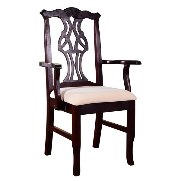 This traditional Chippendale dining arm chair adds timeless elegance to any existing dining room decor. This gorgeous upholstered arm chair showcases elegance and easy to maintain solid beechwood construction that is available in your choice of three finishes to more closely match your specific home decorating needs. The simple yet beautiful cream upholstery color accents the delightful carved lines of the chair back.        Constructed for maximum weight capacity    Set includes: One (1) arm chair    Materials: Solid beech wood    Finish options: Medium oak, walnut or dark mahogany    Upholstery materials: Microfiber    Upholstery color: Cream    Upholstery fill: Foam    Seat dimensions: 17.5 inches wide x 16 inches deep    20.5 x 24.75 x 40