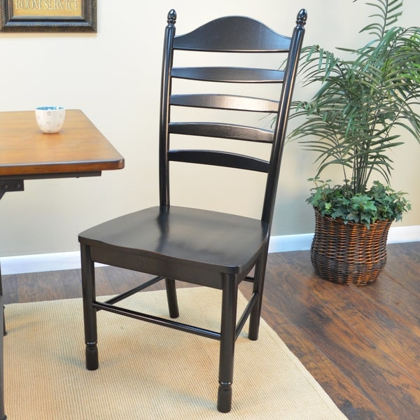 Give yourself a stylish and comfortable place to sit with this ladder back chair. Crafted from 100 percent solid Asian hardwood, this chair provides a sturdy place to relax. The durable finish comes in different colors so you can easily match it to living room, dining room or kitchen table.  Complement your dining table with this stylish Mason chair and enjoy enhanced comfort during family dinners. This chair features a 20-inch-wide seat and a slightly curved back to promote a healthy posture. Rubbed edges give this design a clean, polished look and makes this piece of furniture easy to incorporate into multiple color schemes.    Set includes: One (1) Chair  Made from 100-percent solid select Asian hardwood  Beautiful multi step hand finish with rubbed edges for a worn unique look  Easy to clean durable finish  This product is intended for residential use only.  Manufacturer's Warranty (including Return Policy) is null and void if used in an improper setting.  Finish: Antique black, English pine, Espresso, Harvest Oak  Materials: 100-percent solid select Asian hardwood  Weight: 20 lbs  Seat dimensions: 17.5 inches high x 20 inches wide x 16.75 inches deep  Dimensions: 42 inches high x 20 inches wide x 33.5 inches deep