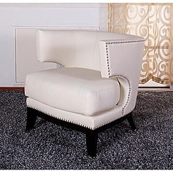 Add distinctive styling to your home decor with this club chair    Chair features buttery smooth, retro faux-leather upholstery    Modern chair is available in cream color option    Upholstery is easy to clean    Features 1.8 density foam padding   California fire retardant foam   Dimensions are 30 inches wide x 28 inches deep x 28 inches high        All sizes and measurements are approximate. Color accuracy of product images vary depending on monitor settings