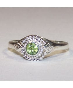 Treat yourself to beauty with a Handmade Peridot Ring  Ring handcrafted by skilled artisans in India  Handmade jewelry features vivid green of peridot stone  Silver beads design  Adjustable size     All carat weights and measurements are approximate and may vary slightly from the listed dimensions. Treatment code E. See   Gemstone Treatments  for further information.       What is Worldstock?      The handcrafted touch of artisan skill creates variations in color, size and design. If buying two of the same item, slight differences should be expected. Note: Color discrepancies may occur between this product and your computer screen.        All measurements are approximate and may vary slightly from the listed dimensions.