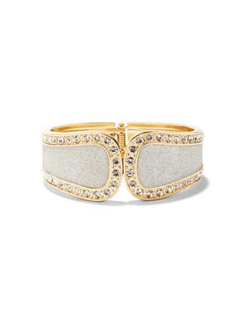 Glitter Hinge Bracelet Go-to glam! Shimmering accents complement the glitter finish on our polished goldtone hinge bracelet. overview Hinge bracelet. Bracelet width: 2-1/4 inches. Mixed metal, glass. Imported.