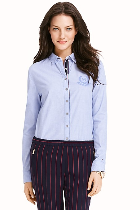 Tommy Hilfiger Women's Shirt. Little Details Make A Big Difference, As Seen In This Feminine Bent On The Menswear Classic. Featuring A Grosgrain Ribbon Placket, Pinstripes At The Sleeves And Our Embroidered Crest At The Chest. Styled In Soft-Washed Cotton That Feels Unexpectedly Airy. Classic Fit. 100% Cotton. Shrunken Spread Collar, Princess Seams, Microflag At Cuff. Machine Washable. Imported.