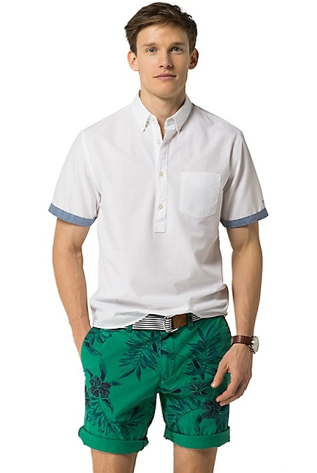 Tommy Hilfiger Men's Shirt. Just In Time For The Warmer Months, Our Popover Short-Sleeve Shirt Adds Casual Flair To Your Wardrobe Without Skipping On Button-Down Charm. Washed For Softness In Our Slim, Modern Fit. New York Fit (Our Slimmest Fit). 91% Cotton, 9% Linen. Button-Down Collar, Half-Placket, Contrast Cuffs, Chest Pocket. Machine Washable. Imported.