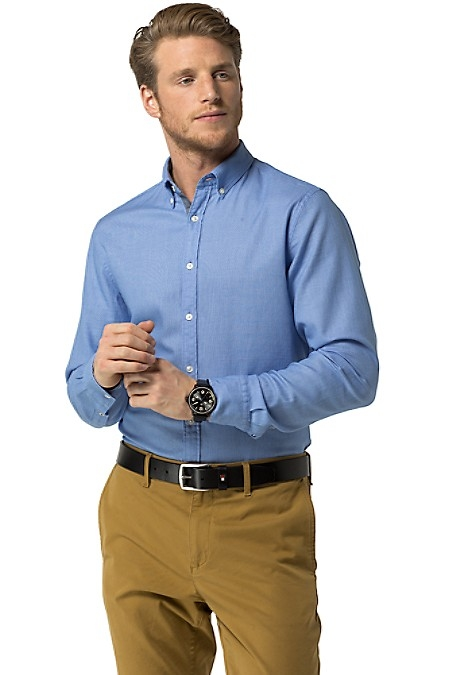 Tommy Hilfiger Men's Shirt. Our Classic Button Down Shirt In Pure, Premium Cotton. Washed For Softness In Our Modern Fit. New York Fit (Larger Than Slim Fit, Slimmer Than Classic Fit). 100% Cotton. Button-Down Collar. Machine Washable. Imported.