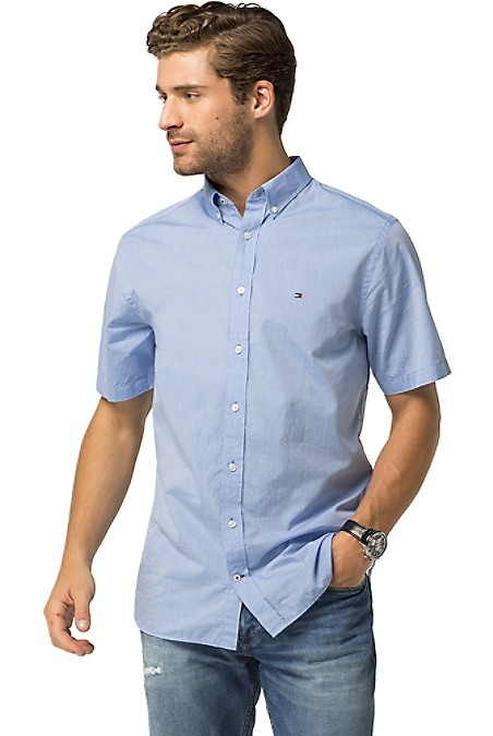 Tommy Hilfiger Men's Shirt. Leave It To Us To Make The Short Sleeve Shirt Cool Again. Styled From Lightweight Cotton In A Custom Fit That Looks And Feels Like It Was Made For You. Custom Fit (A Tailored Version Of Our Classic Fit, Cut Slimmer Through The Chest And Shoulders). 100% Cotton. Button-Down Collar. Machine Washable. Imported.