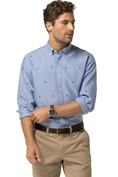 Tommy Hilfiger Men's Shirt. An Alternative To Your Standard Button-Down, This Shirt Gets A Dash Of Hilfiger Flair With Allover 'H' Embroidery. New York Fit (Larger Than Slim Fit, Slimmer Than Classic Fit). 100% Cotton. Button-Down Collar. Machine Washable. Imported.