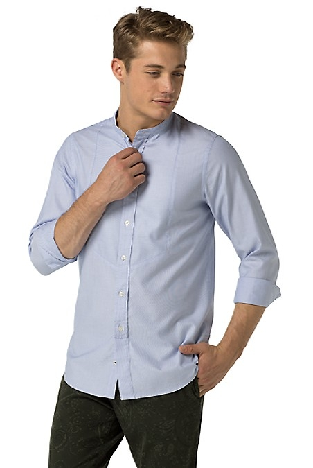 Tommy Hilfiger Men's Shirt. The Classic Oxford Shirt Gets A Revamp With A Bib Front And Mandarin Collar. Styled In Our Trimly Tailored, Slim Fit And Spun From Pure, Premium Cotton. Slim Fit (Our Slimmest Fit Tailored With Clean Lines Throughout). 100% Cotton. Mandarin Collar. Machine Washable. Imported.