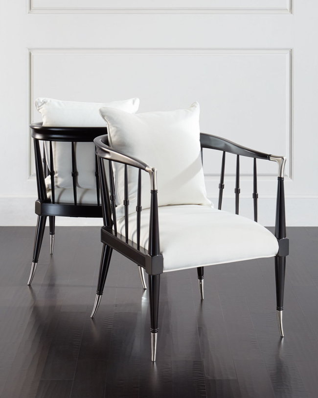 Handcrafted Windsor-style chair. Chair sold individually; pair shown here for detail. Asian hardwood frame with chrome accents. Polyester/cotton upholstery. Plush poly foam cushion; feather/down pillow. 26W x 29.5D x 30.25T. Seat, 22W x 18D x 19T; arms, 28.75T. Imported. Boxed weight, approximately 47 lbs.