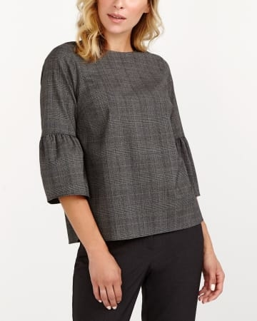 You will fall for this bell sleeve blouse! Featuring a rounded neck with a zip fastener at the back and  bell sleeves, this striped blouse will quickly become a must-have of the chilly season. Pair it with jeans and high heels for a flawless sophisticated look.<br /><br />Ready to wear for: a special occasion, a dinner with the girls, the offic.Grey/ Black Plaid.XXS