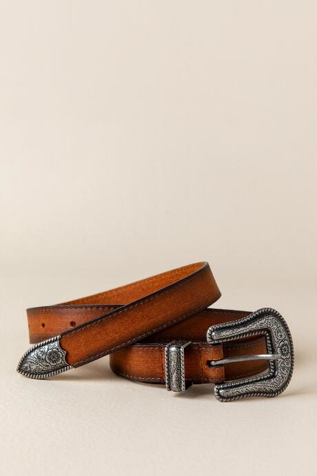 Bev Western Buckle leather Belt in Cognac features a cognac leather belt with a floral metal buckle and detail.