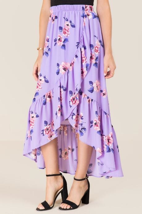 The Talia Floral Ruffle Skirt features pink flowers on the oxford blue background.
