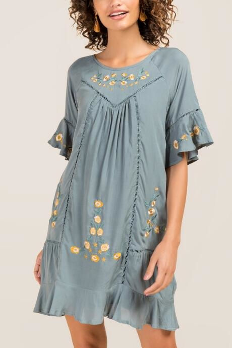 The Juliette Floral Shift Dress features cute ruffled sleeves.