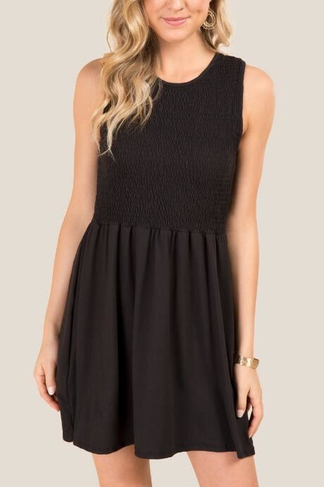 Alexi Sleeveless Babydoll Knit Dress is a little black dress that can be dressed up or down for any occasion.